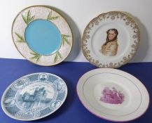 Four similarly sized collector's plates: the largest being a 19th century Majolica example (23.4cm