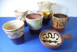 A group of six 1950s Winchcombe Pottery slipwares; to include a tankard by Ray Finch incised 'A.V.H.