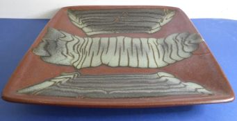 A press-moulded square dish by Don Jones; unmarked and with glaze trail decoration in the manner