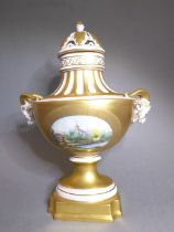 A fine hand-gilded and decorated Dresden porcelain urn and cover; the reticulated domed top above