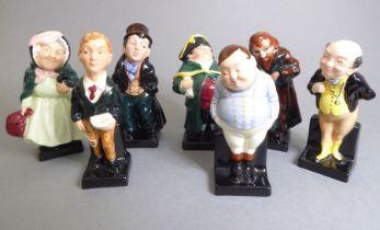 Seven Royal Doulton hand-decorated porcelain Charles Dickens figure models: 'Fagin', 'Artful
