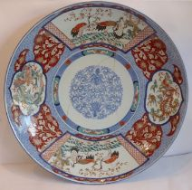 An exceptionally large(approx 61cm in diameter)19th century Japanese porcelain dish/charger;