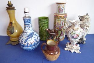Ceramics to include vases, a fireside model of a seated cat and a 19th century Lambeth Doulton