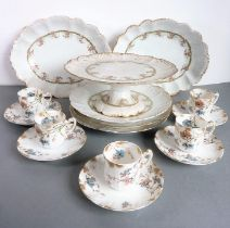 An Edwardian porcelain part dessert service comprising comport, three plates and two boat-shaped
