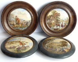 Two pairs of circular framed pot lids: two oak-framed pot lids in Prattware style and two ebony-