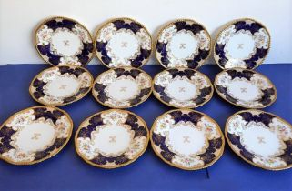 A set of 12 early 20th century fine Coalport porcelain dessert plates: raised, beaded gild rims;
