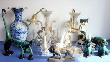 Eight green glazed ceramic animals including dogs, a cat and an open-winged bird (the tallest 46.5cm