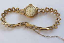 A lady's 9 carat yellow gold wristwatch by Accurist; the circular dial with Arabic numerals and