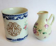A large late 18th century Chinese export porcelain tankard; decorated in the famille rose palette