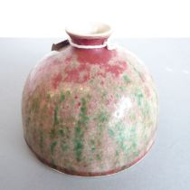 Qing Dynasty - a Chinese ceramic water pot. The small, circular, waisted neck above a mottled red,