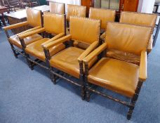 A good harlequin matched set of eight tan-leather-upholsteredsolid oak open armchairs;late 19th /