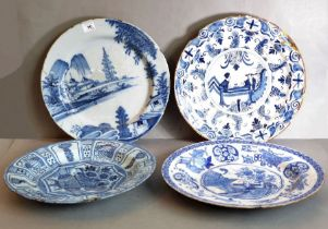 Delft - four large dishes 17th and 18th century, one with an attractive watery landscape, another in