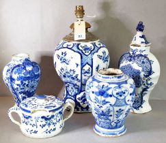 A Dutch Delft vase and cover of shield shape painted in blue with a vase of flowers; a vase with