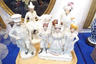 Four 19th century Staffordshire figures: 'Wolseley', 'Em. Napoleon', 'Kitchener' and a triple