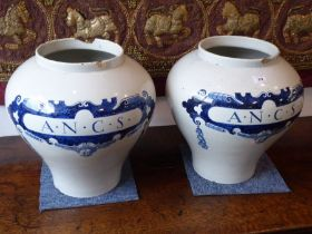 A pair of early style (early 20th century) large Dutch Delft baluster-shaped cannisters (possibly