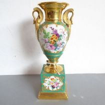 A mid-19th century Paris-style vase of urn form; hand-gilded and decorated with floral sprays, two