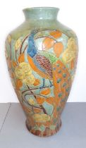 A large late 19th / early 20th century baluster-shaped pottery vase in the style of C.H. Brannam: