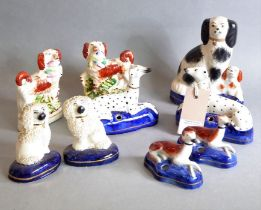 A selection of 19th century hand-decorated Staffordshire dogs to include a pair of King Charles