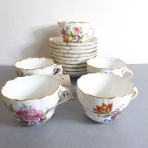 Five continental porcelain cups andnine matching saucers. Each individually decorated in enamels