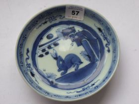A small 17th / 18th centuryChinese porcelain dish. Hand-decorated in underglaze blue with a hare