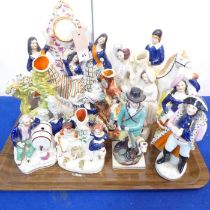 Eleven 19th century Staffordshire figures to include a pocket-watch holder, a spill vase with a