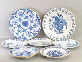 Delft - three English plates each painted with a flowering tree above water; two plates with brown