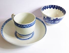 A late 18th/early 19th century Tournai blue and white ribbed cup and saucer; the saucer with painted