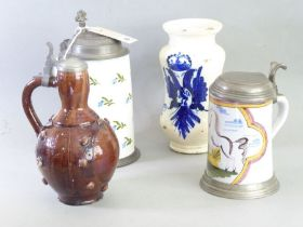 Four German / East European pieces: a German creamware Humpen of typical form, painted with sprigs