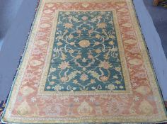 A modern hand-knotted Afghan K.K.Super Zeigler carpet with salmon and green ground (refugee