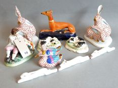 A good selection of ceramics, mostly hare and hound: a pair of Herend models of hares (damage and