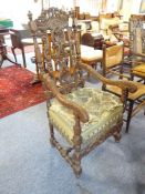A late 17th century style (good reproduction) open-armed carved walnut armchair of generous