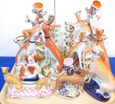 Nine 19th century Staffordshire figures. Mostly greyhounds, longdogs and whippets. To include two