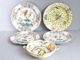 Majolica; a dish and a pair of plates, probably Le Nove, enamelled in vaguely famille verte style