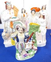Five 19th century hand-decorated Staffordshire figures; the largest a Scotsman with bagpipes (