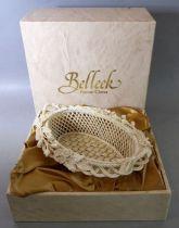 A Belleek Parian China basket-weave oval basket; printed mark to underside, in its original box (