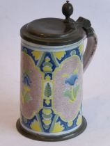 An 18th/19th century Continental pottery and pewter mounted tankard of large proportions; three