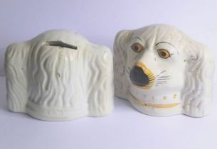 A pair of 19th century Staffordshire pottery money boxes modelled as spaniel's heads (12cm wide x