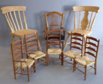 Eight miniature chairs: a set of five rush-seated ladderback chairs (one with arms), two natural
