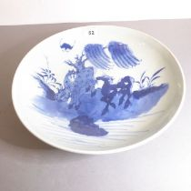 Yongzheng period (1723-1735) - a Chinese porcelain bowl decorated in underglaze blue with two horses