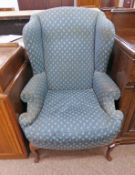 WING ARMCHAIR WITH BLUE COVERING & SHAPED SUPPORTS