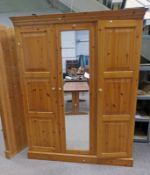PINE MIRROR DOOR WARDROBE WITH PANEL DOOR TO EITHER SIDE .