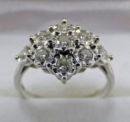 9 CARAT GOLD DIAMOND SET CLUSTER RING Condition Report: Ring size: M.