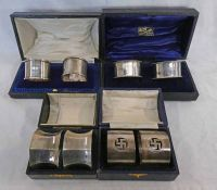 4 CASED SETS OF 2 SILVER NAPKIN RINGS,