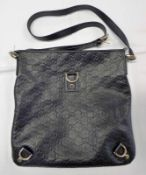 BLACK LEATHER GG EMBOSSED GUCCI MESSENGER BAG WITH GILT DETAILS