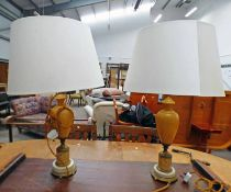 PAIR OF TABLE LAMPS ON CIRCULAR BRASS BASES DECORATED WITH CLASSICAL SCENES