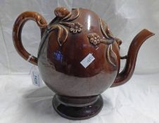 19TH CENTURY BRAMELD POTTERY TREACLE GLAZED CADOGAN TEAPOT DECORATED WITH FLOWERS AND BERRIES -