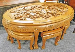 EASTERN CARVED HARDWOOD OVAL NEST OF 7 TABLES ON CLAW FEET
