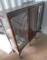 MAHOGANY BOW FRONT DISPLAY CASE ON BALL AND CLAW SUPPORTS