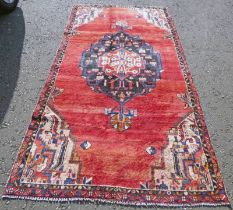 WASHED RED GROUND PERSIAN SAROUK RUG WITH A LARGE CENTRAL MEDALLION 270 X 132CM Condition