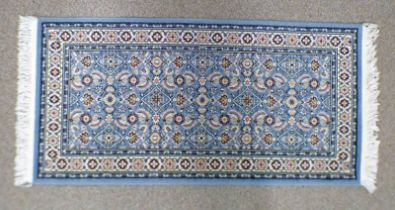 BLUE GROUND FLORAL DECORATED RUG 144 X 70 CM